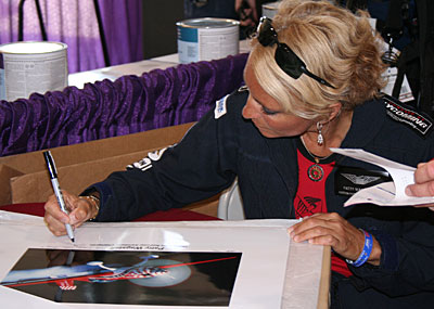 Patty Wagstaff signing posters